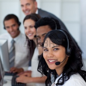 10073574-portrait-of-a-businesswoman-in-a-call-center-with-her-team