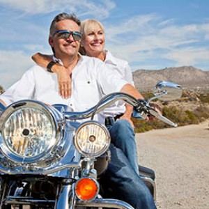Retirees on a motorcycle enjoying the countryside